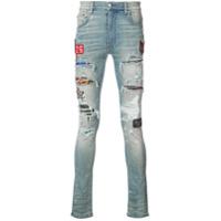 Amiri Calça jeans skinny com aplicação de patch - Azul